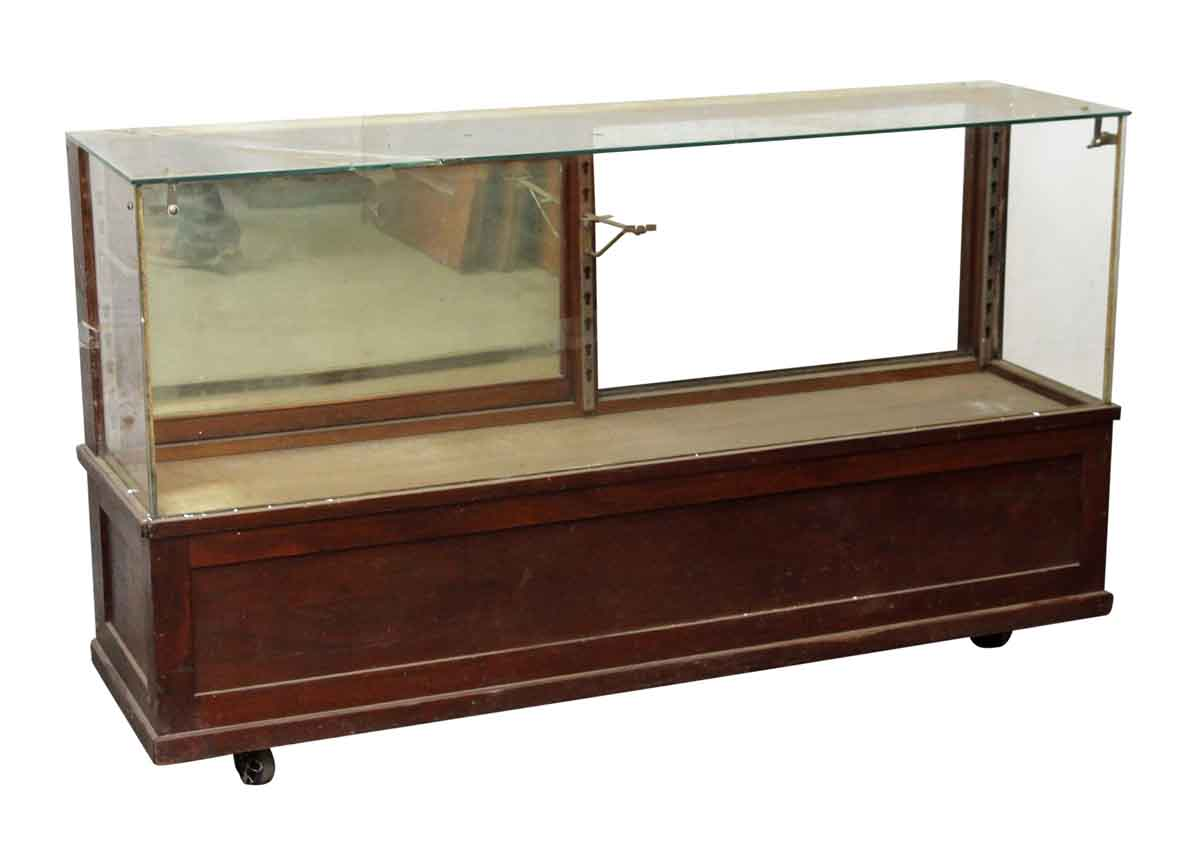Vintage wooden glass front showcase on wheels olde good for Commercial furniture