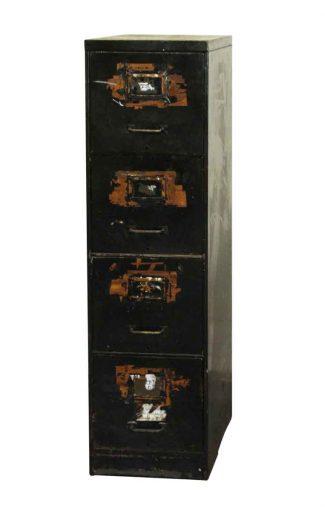 Worn Four Drawer Metal Filing Cabinet
