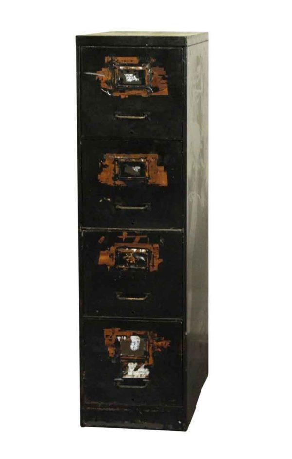 Office Furniture - Worn Four Drawer Metal Filing Cabinet