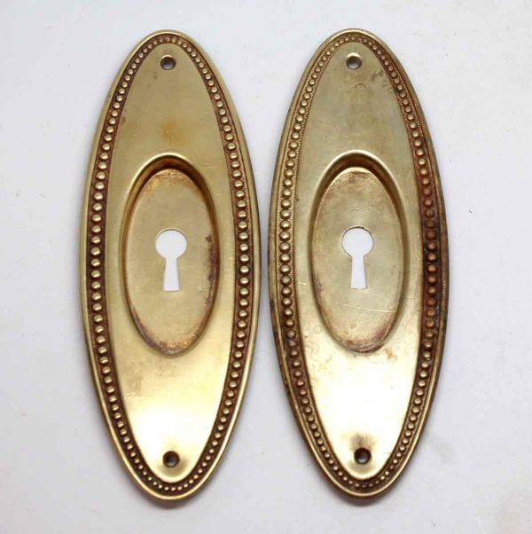 Pocket Door Hardware - Pair of Polished Brass Beaded Oval Pocket Door Plates