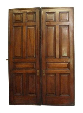 Pair Of Wheeled Seven Panel Pocket Doors