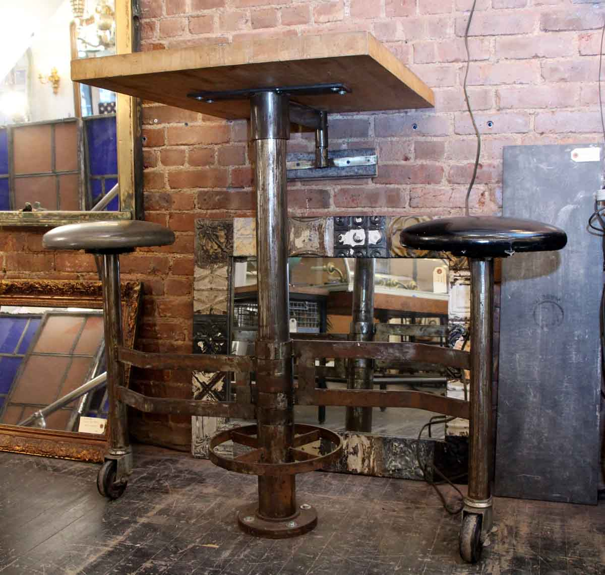 Fabulous Industrial Wall Mounted Counter Height Table With Attached Rolling Stools Creativecarmelina Interior Chair Design Creativecarmelinacom