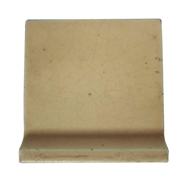 Bull Nose & Cap Tiles - Orange Peach Inside Curved 4.5 in. Square Baseboard Tile