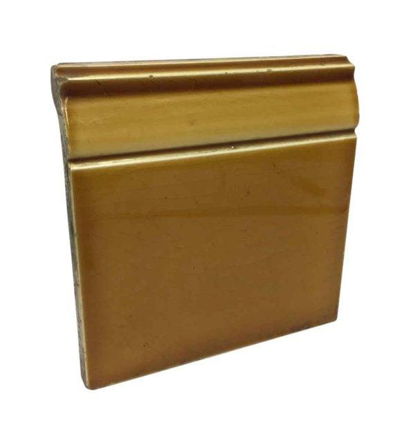 Bull Nose & Cap Tiles - Orange Baseboard Tile