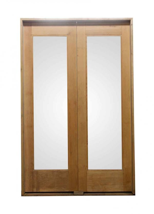 Commercial Doors - Pair of Light Wood Tone Doors with Glass Panels in Frame